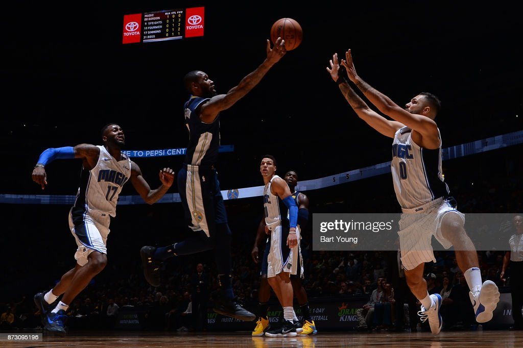 Will Barton #5 of the Denver Nuggets shoots the ball against Evan Fournier #10 of the Orlando Magic on November 11, 2017 at the Pepsi Center in Denver, Colorado.
