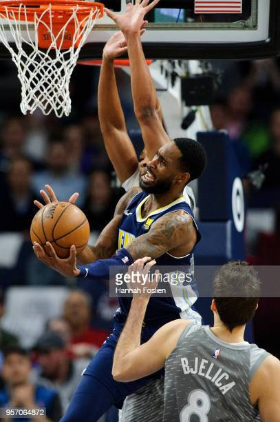 Will Barton of the Denver Nuggets shoots the ball against Taj Gibson and Nemanja Bjelica of the Minnesota Timberwolves during the game on April 11...