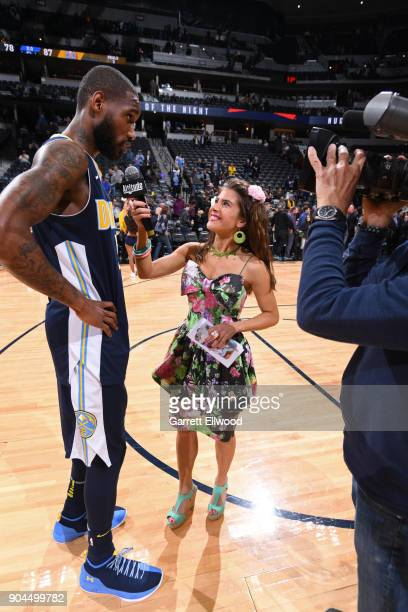 Will Barton of the Denver Nuggets talks to the media on the court after the game against the Memphis Grizzlies on January 12 2018 at the Pepsi Center...