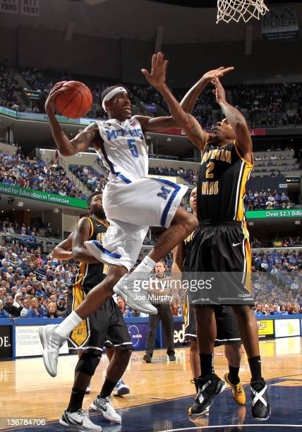 Will Barton of the Memphis Tigers passes the ball against Darnell Dodson of the Southern Miss Golden Eagles on January 11, 2012 at FedExForum in...
