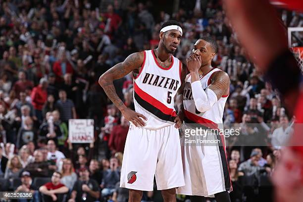 Will Barton of the Portland Trail Blazers talks with Damian Lillard during the game against the Washington Wizards on January 24 2015 at the Moda...