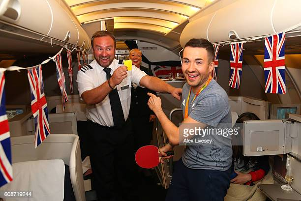 Will Bayley of the Paralympics GB Team jokes around with a member of the British Airways cabin crew as they fly back from Rio onboard the British...