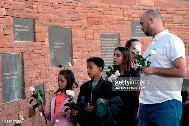 Will Beck a Columbine High School massacre survivor and his family visit the Columbine Memorial at Clement Park in Littleton Colorado during a...