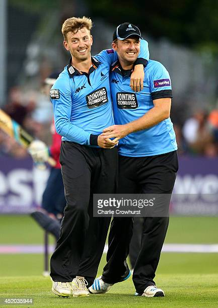 Will Beer of Sussex celebrates with team mate Chris Nash after claiming the wicket of Sam Billings of Kent during the Natwest T20 Blast match between...