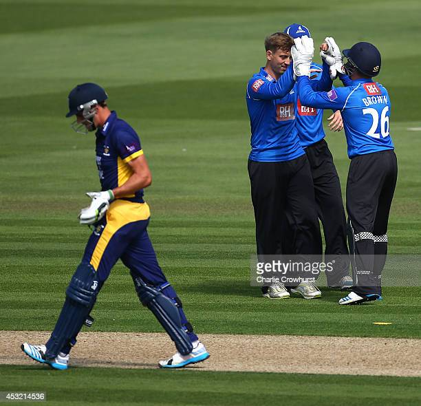 Will Beer of Sussex celebrates with team mates after bowling out Calum MacLeod of Durham during Royal London OneDay Cup match between Sussex Sharks...