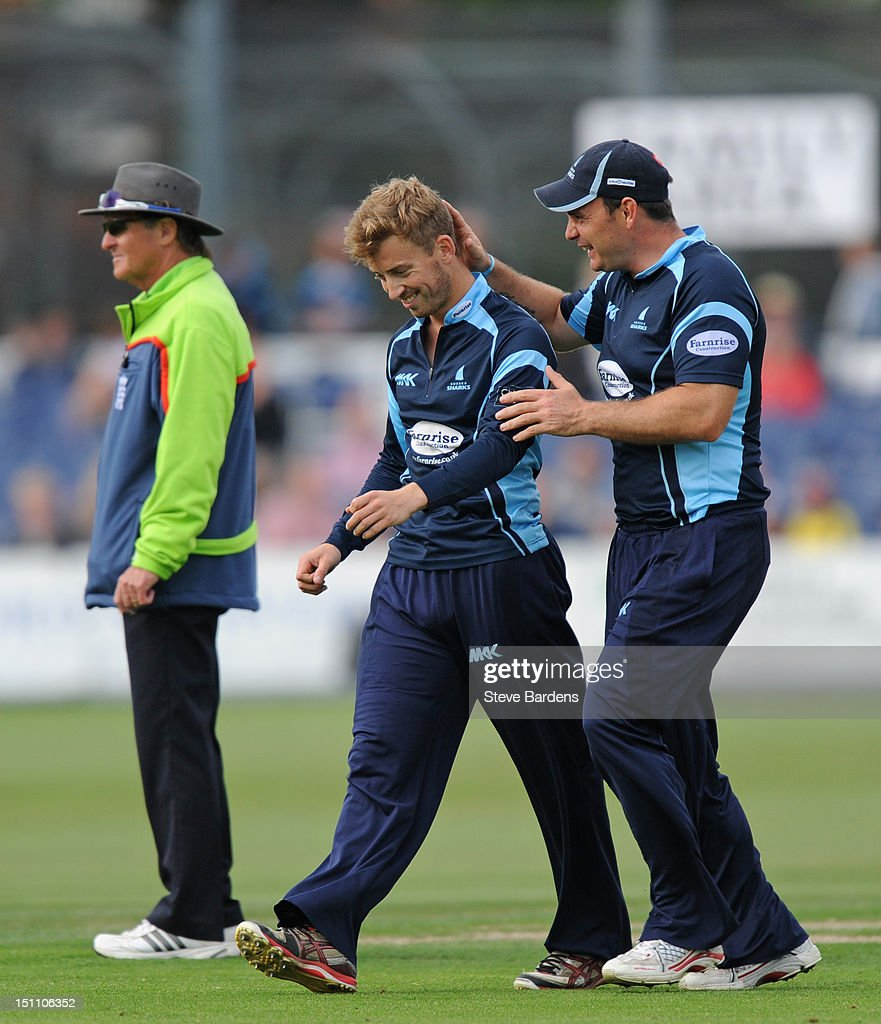 Will Beer of Sussex Sharks celebrates the wicket of Michael Carberry of Hampshire Royals with Mike Yardy during the Clydesdale Bank Pro40 semi final match between Sussex and Hampshire at the Probiz County Ground on September 1, 2012 in Hove, England.