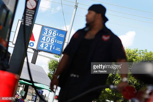 Will Bernett pumps gas into his car as a sign shows the price of a gallon of gas September 15 2008 in Miami Florida Gasoline prices rose nearly 5...