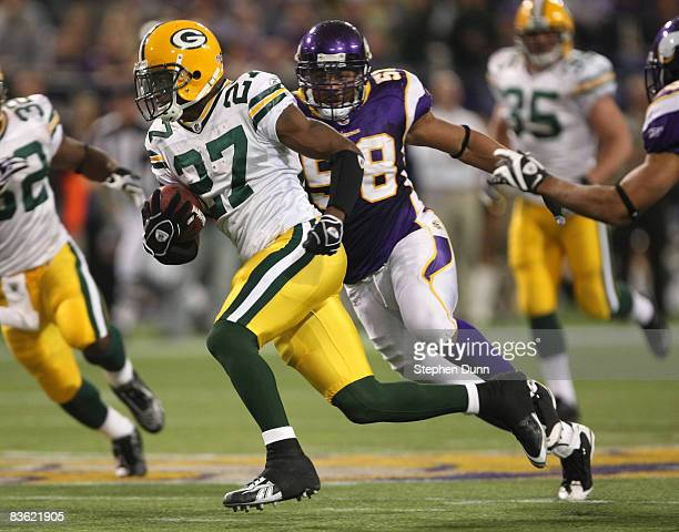 Will Blackmon of the Green Bay Packers returns a punt 65 yards for a touchdown against the Minnesota Vikings on November 9, 2008 at the Metrodome in...