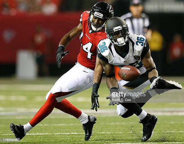 Will Blackmon of the Jacksonville Jaguars intercepts a pass intended for Martel Moore of the Atlanta Falcons at Georgia Dome on August 29, 2013 in...