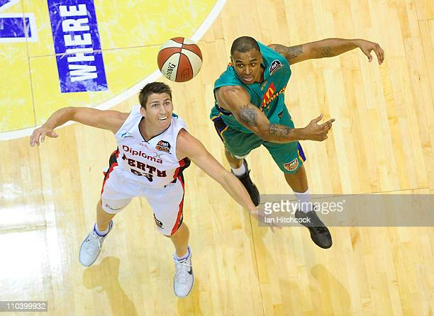 Will Blalock of the Crocodiles contests a loose ball with Damian Martin of the Wildcats during the round 23 NBL match between the Townsville...