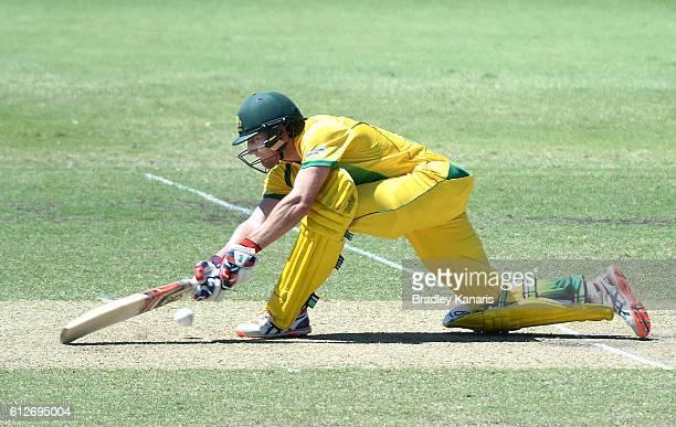 Will Bosisto of the CA XI plays a sweep shot during the Matador BBQs One Day Cup match between Tasmania and the Cricket Australia XI at Allan Border...