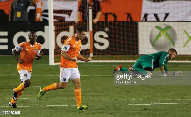 Will Bruin and Boniek Garcia of the Houston Dynamo celebrate after Bruin scored a first half goal past Matt Lampson of the Columbus Crew at BBVA...