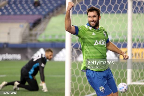 Will Bruin celebrates his assist to Jordan Morris of Seattle Sounders to score a goal in the first half against Andrew Putna of Real Salt Lake and...