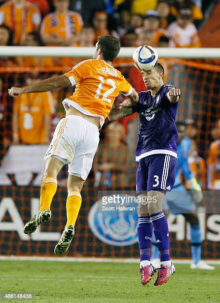Will Bruin of Houston Dynamo battles for the ball with Seb Hines of Orlando City SC during their game at BBVA Compass Stadium on March 13, 2015 in...