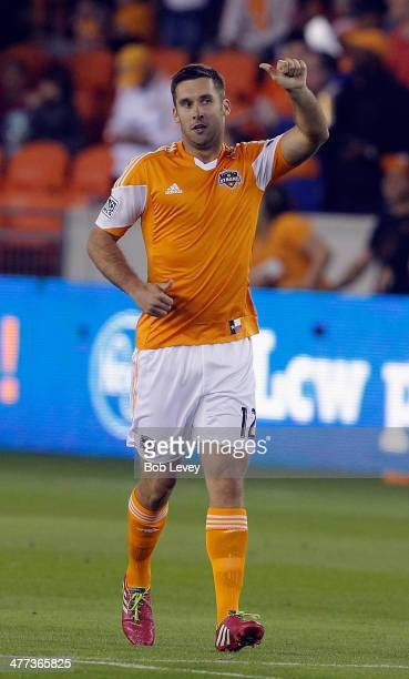 Will Bruin of Houston Dynamo celebrates his first of goal of the half against the New England Revolution at BBVA Compass Stadium on March 8 2014 in...