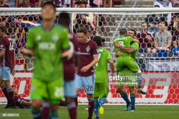 Will Bruin of Seattle Sounders celebrates a goal with Victor Rodriguez of Seattle Sounders against the Colorado Rapids at Dick's Sporting Goods Park...
