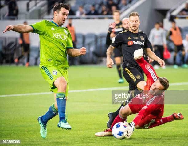 Will Bruin of Seattle Sounders charges in on goal at Tyler Miller of Los Angeles FC defends during Los Angeles FC's MLS match against Seattle...