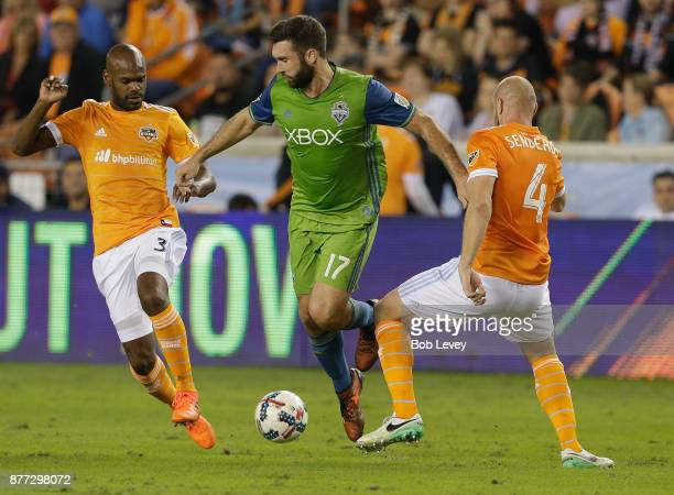 Will Bruin of Seattle Sounders dribbles between Adolfo Machado of Houston Dynamo and Philippe Senderos in the first half at BBVA Compass Stadium on...
