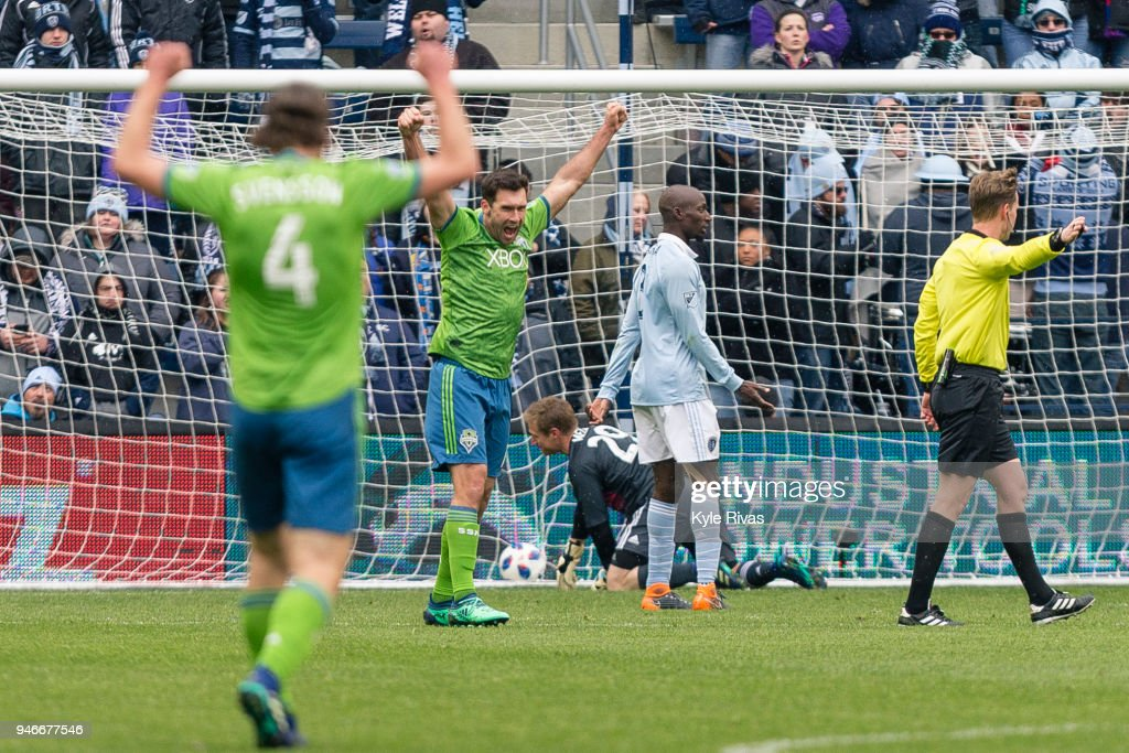 Will Bruin #17 of Seattle Sounders reacts to the goal by Cristian Roldan #7 of Seattle Sounders against Sporting Kansas City during the second half on April 15, 2018 at Children's Mercy Park in Kansas City, Kansas.