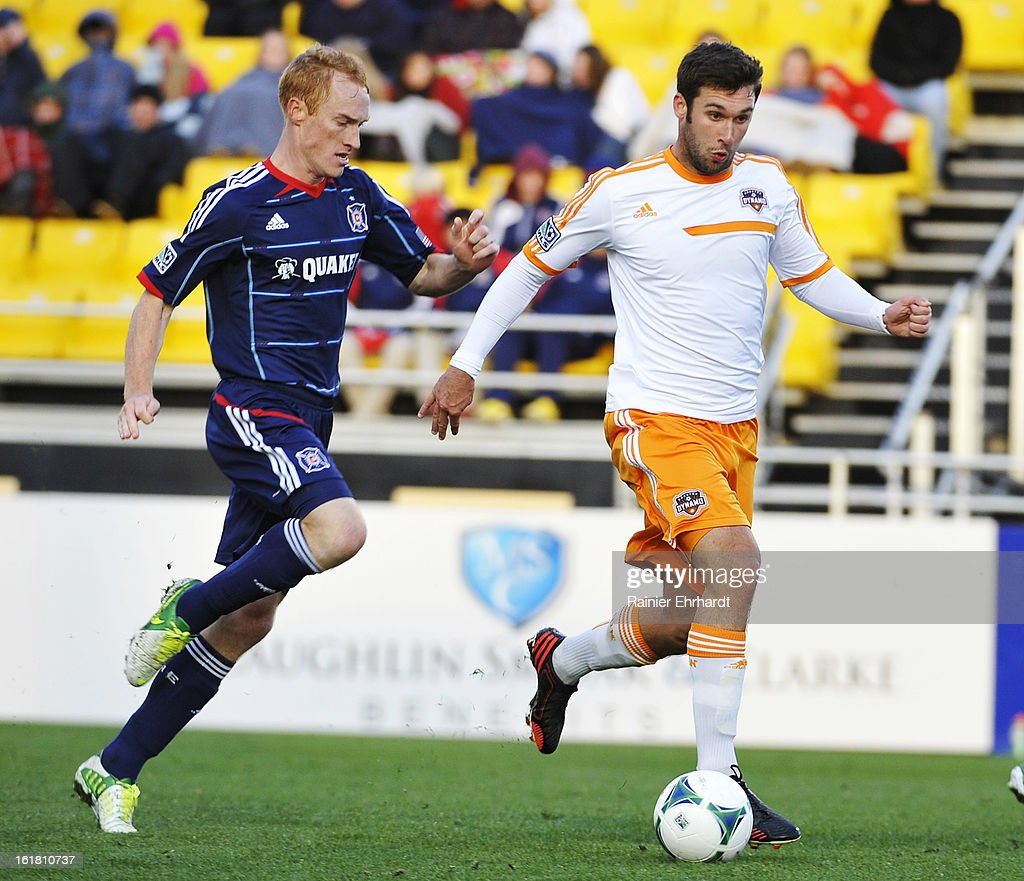 Will Bruin #12 of the Houston Dynamo battles for the ball against Jeff Larentowicz #20 of the Chicago Fire during the first half of their game in the Carolina Challenge Cup at Blackbaud Stadium on February 16, 2013 in Charleston, South Carolina.