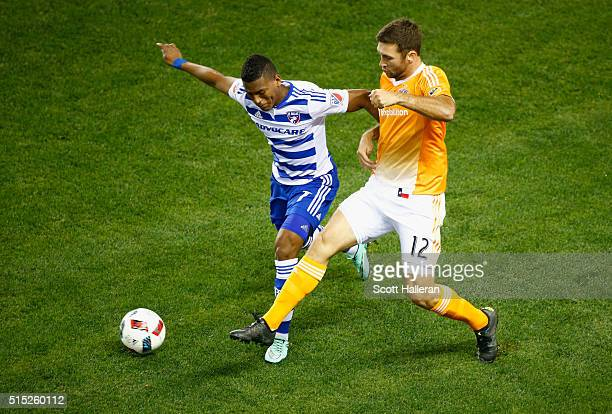 Will Bruin of the Houston Dynamo battles for the ball with Carlos Gruezo of FC Dallas during their game at BBVA Compass Stadium on March 12 2016 in...