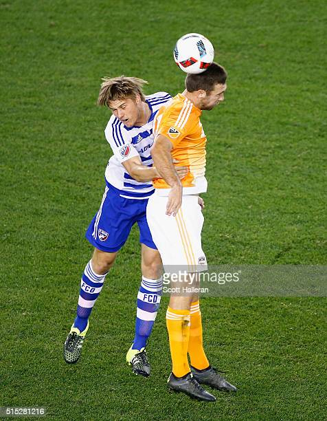 Will Bruin of the Houston Dynamo battles for the ball with Walker Zimmerman of FC Dallas during their game at BBVA Compass Stadium on March 12 2016...