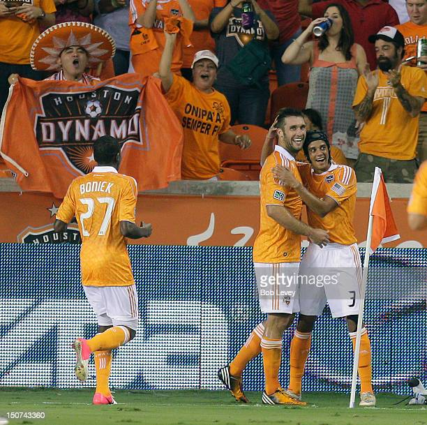 Will Bruin of the Houston Dynamo celebrates with Calen Carr of the Houston Dynamo and Boniek Garcia of the Houston Dynamo after scoring against the...