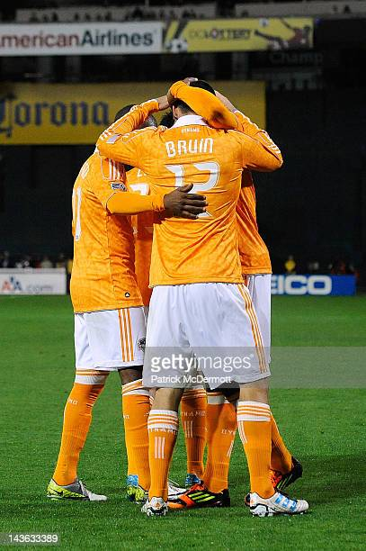 Will Bruin of the Houston Dynamo celebrates with his teammates after scoring a goal against the DC United at RFK Stadium on April 28 2012 in...