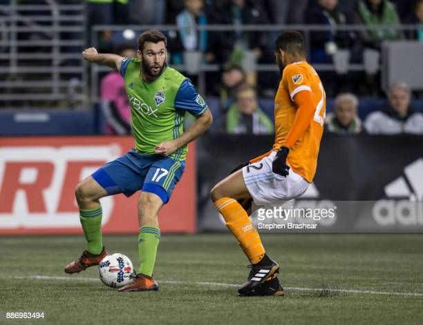 Will Bruin of the Seattle Sounders looks to pass against Leonardo of the Houston Dynamo during the second leg of the MLS Western Conference Finals at...