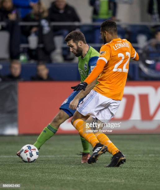 Will Bruin of the Seattle Sounders passes the ball in front of Leonardo of the Houston Dynamo during the second leg of the MLS Western Conference...