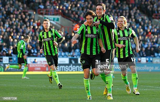 Will Buckley of Brighton celebrates his first goal with team mate Lewis Dunk during the npower Championship match between Huddersfield Town and...