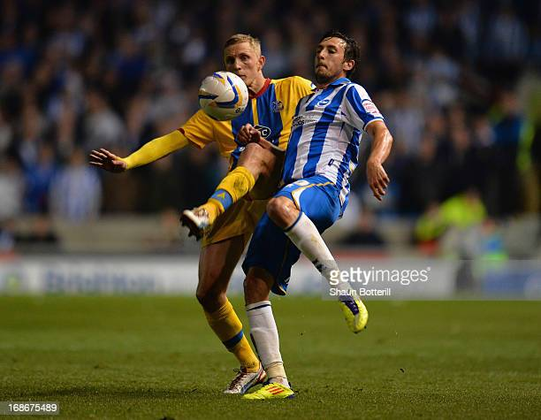 Will Buckley of Brighton Hove Albion is tackled by Danny Gabbidon Dean Moxey of Crystal Palace during the npower Championship play off semi final...