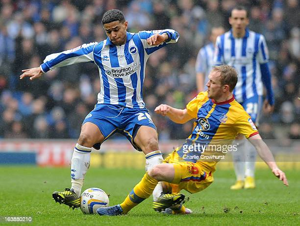 Will Buckley of Brighton is tackled by Jonathan Williams of Crystal Palace during the npower Championship match between Brighton Hove Albion and...