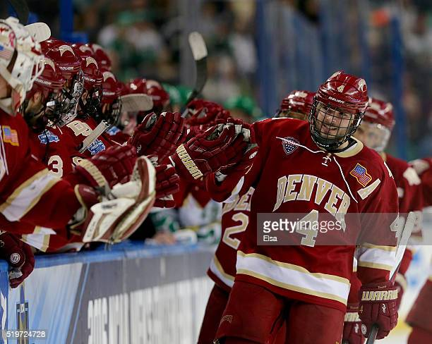 Will Butcher of the Denver Pioneers celebrates his goal with teamamtes on the bench in the third period against the North Dakota Fighting Hawks...