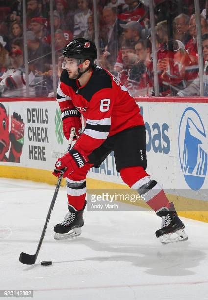 Will Butcher of the New Jersey Devils plays the puck against the Columbus Blue Jackets during the game at Prudential Center on February 20 2018 in...