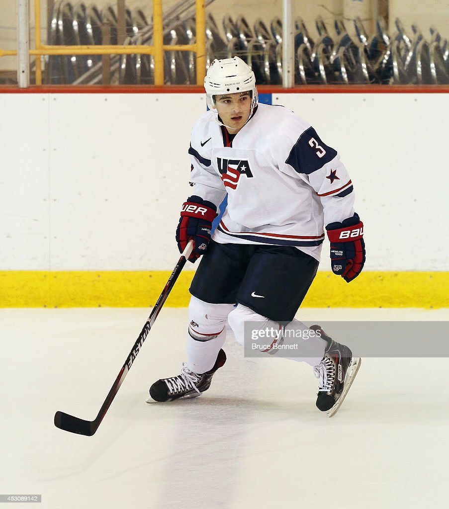 Will Butcher #3 of USA White skates against USA Blue during the 2014 USA Hockey Junior Evaluation Camp at Lake Placid Olympic Center on August 2, 2014 in Lake Placid, New York.