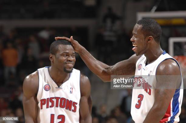 Will Bynum and Rodney Stuckey of the Detroit Pistons joke around on the court during a game against the Orlando Magic in a game at the Palace of...