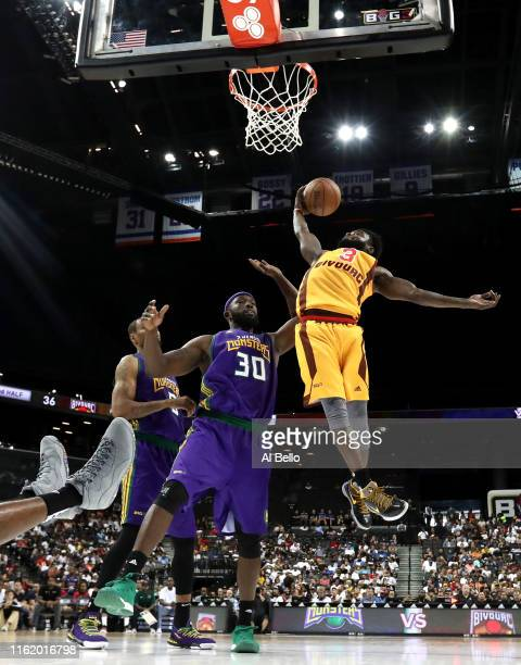Will Bynum of Bivouac goes up with the ball against Reggie Evans of 3 Headed Monsters during week four of the BIG3 three-on-three basketball league...