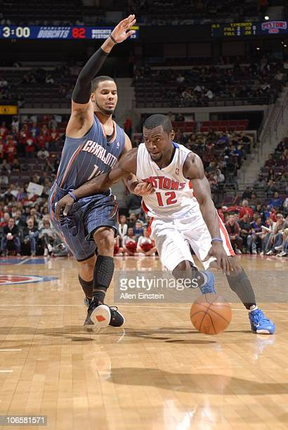 Will Bynum of the Detroit Pistons drives around DJ Augustin of the Charlotte Bobcats in a game on November 5 2010 at The Palace of Auburn Hills in...