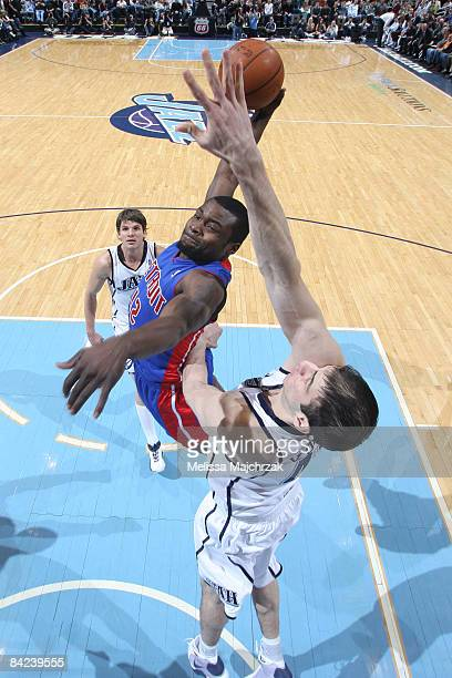 Will Bynum of the Detroit Pistons goes for the dunk as Kosta Koufos of the Utah Jazz tries to block, at EnergySolutions Arena on January 10, 2009 in...