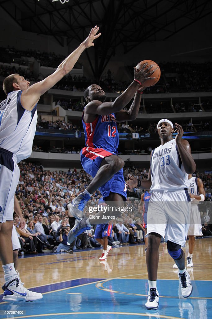 Will Bynum #12 of the Detroit Pistons goes in for the layup against Dirk Nowitzki #41 and Brendan Haywood #33 of the Dallas Mavericks during a game on November 23, 2010 at the American Airlines Center in Dallas, Texas.