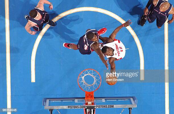 Will Bynum of the Detroit Pistons goes up for a reverse layup past Marvin Williams of the Atlanta Hawks in a game at the Palace of Auburn Hills on...