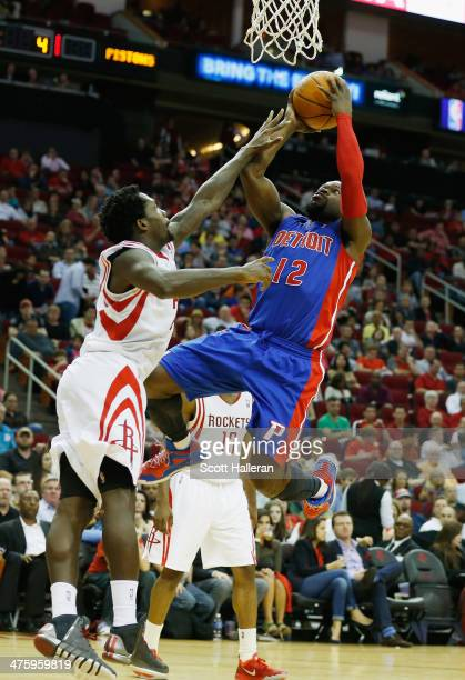 Will Bynum of the Detroit Pistons shoots against Patrick Beverley of the Houston Rockets during the game at the Toyota Center on March 1 2014 in...