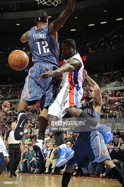 Will Bynum of the Detroit Pistons throws a pass past Tyrus Thomas and D J Augustin of the Charlotte Bobcats in a game on November 5 2010 at The...
