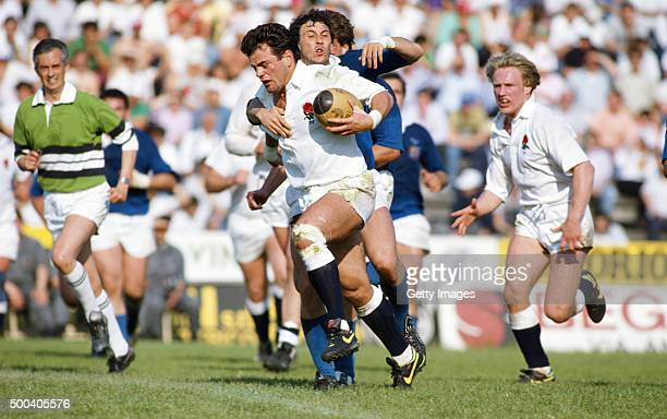 Will Carling of England makes a break watched by Neil Back during a match between Italy and England on May 1 1990 in Rovigo Italy