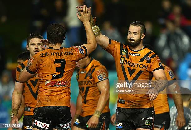 Will Chambers and Aaron Woods of the Tigers celebrate wining the round 16 NRL match between the Wests Tigers and the Melbourne Storm at Leichhardt...