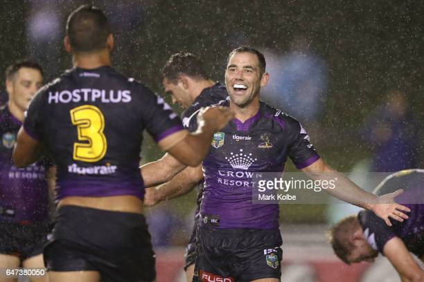 Will Chambers and Cameron Smith of the Storm celebrate victory during the round one NRL match between the Canterbury Bulldogs and the Melbourne Storm...