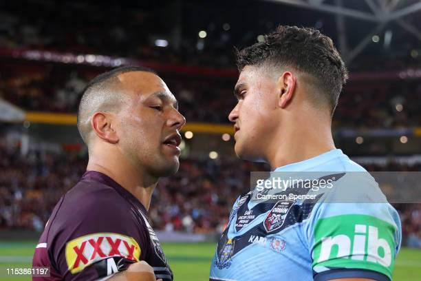 Will Chambers of Queensland embraces Latrell Mitchell of the Blues after winning game one of the 2019 State of Origin series between the Queensland...