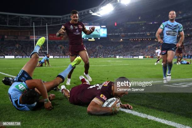 Will Chambers of Queensland scores a try during game two of the State of Origin series between the New South Wales Blues and the Queensland Maroons...