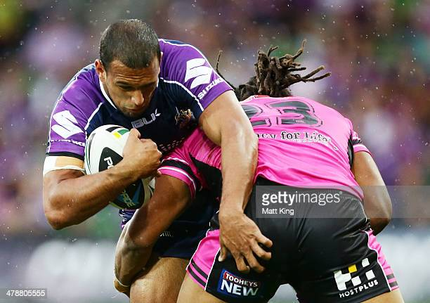 Will Chambers of Storm is tackled by Jamal Idris of the Panthers during the round two NRL match between the Melbourne Storm and the Penrith Panthers...